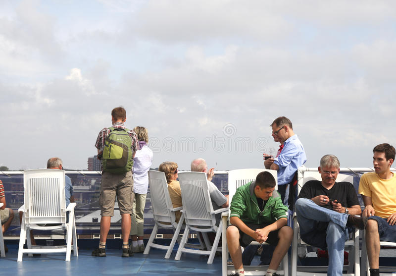 Passengers on the sundeck of the ferry