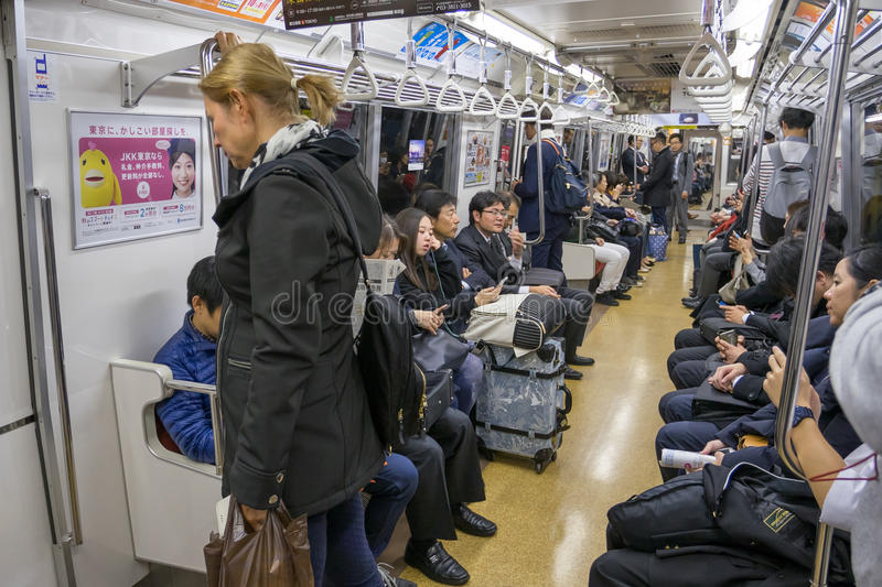 Passengers in train with JR Yamanote line in Tokyo. Tokyo, Japan - November 20, 2016 : Passengers in train with JR Yamanote line in Tokyo Japan on 20 November stock images