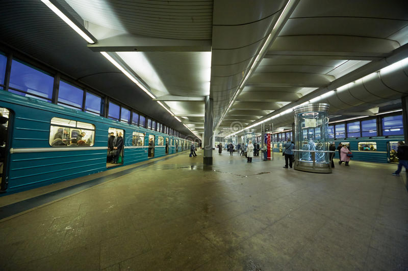 Passengers and trains at subway station stock images
