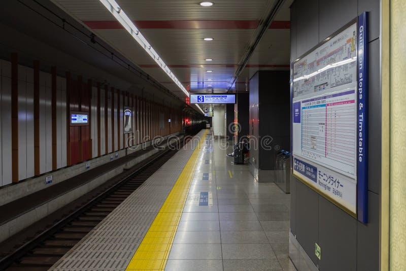 Passengers waiting for Keisei Skyliner train at Narita international airport royalty free stock photos