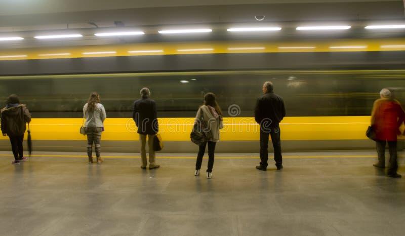 Passengers waiting on metropolitan platform stock image