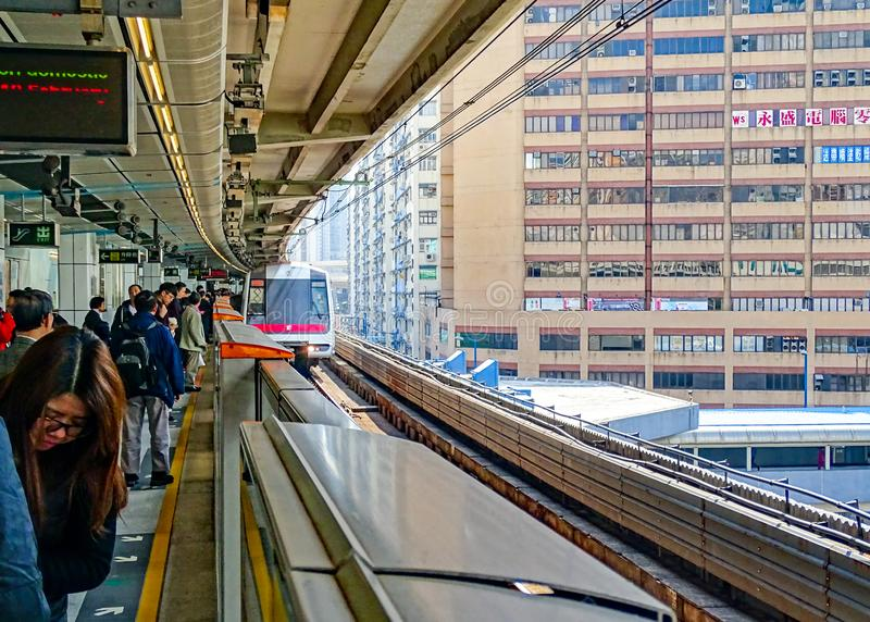 Passengers are waiting on the platform for the Green Line MTR train entering Kwun Tong Station royalty free stock image