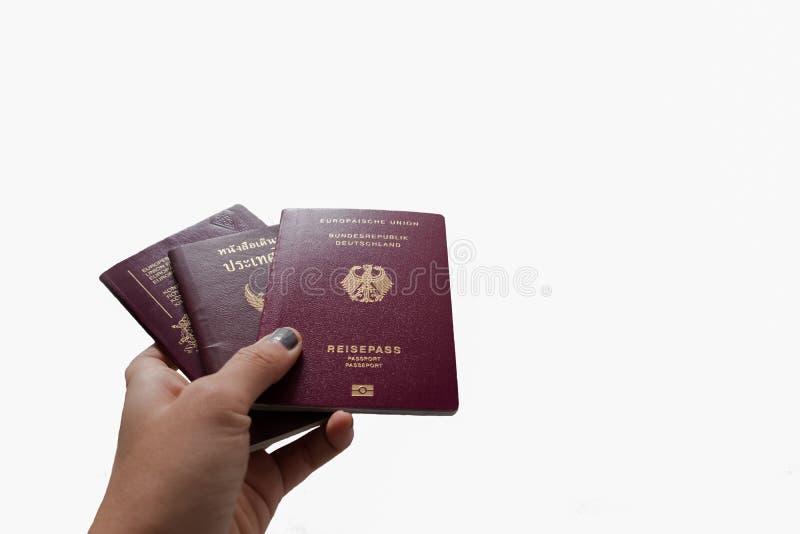 Passeport de l'Allemagne, de la Thaïlande, et de la Belgique d'isolement sur le fond blanc photographie stock