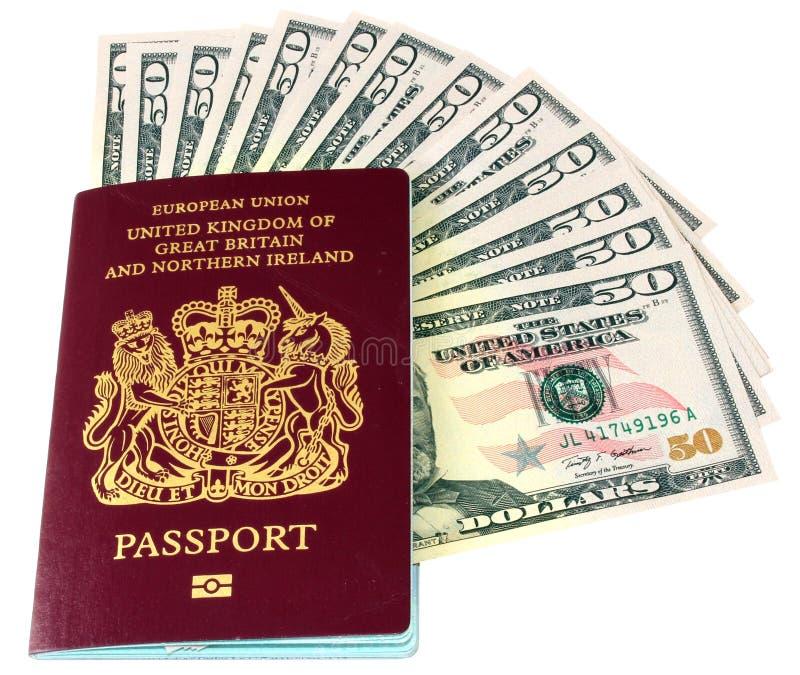Passeport et dollars photographie stock