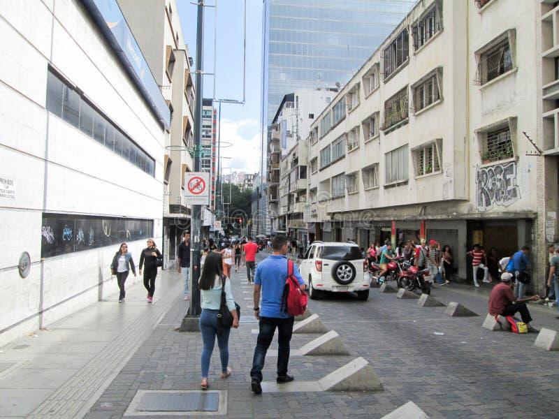 Passersby walking down one of the cross streets on the Boulevard de Sabana Grande, Caracas, Venezuela.  royalty free stock photos