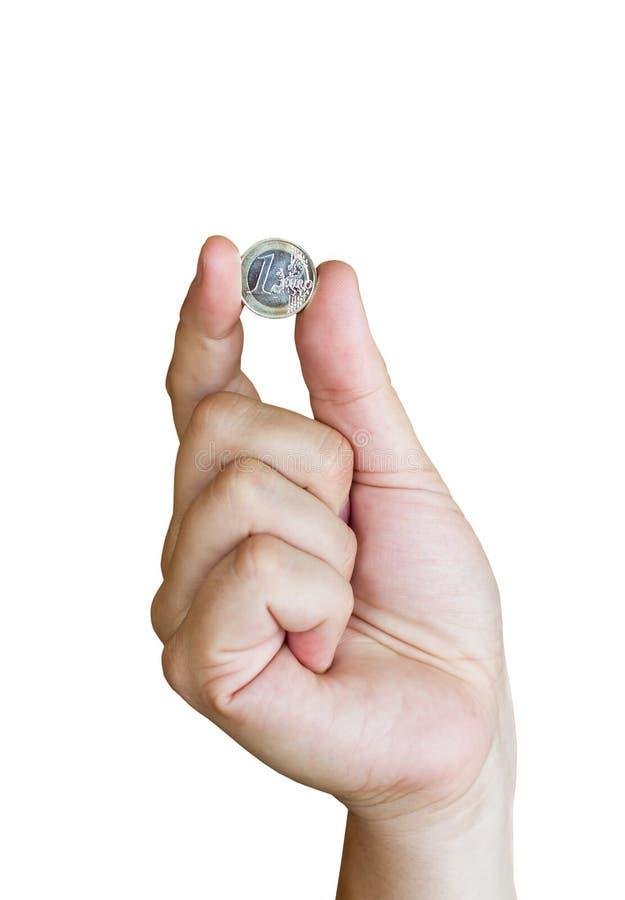 Passi a holding una euro moneta, su priorità bassa bianca fotografie stock
