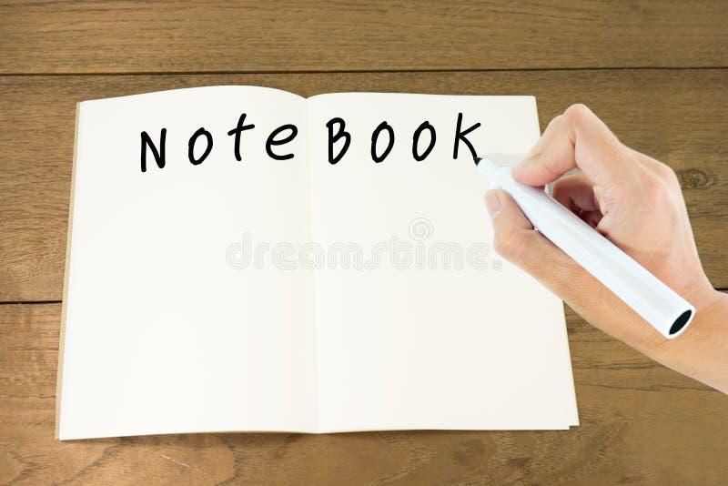 """Passi il  del book†del """"note di parola di scrittura in carta in bianco sulla tavola di legno immagine stock libera da diritti"""