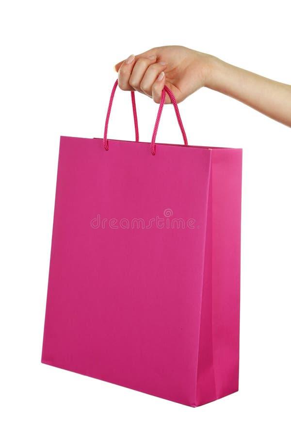 Passi il sacchetto di acquisto della holding immagini stock libere da diritti