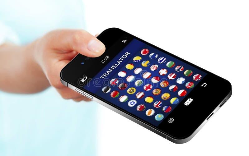 Passi il telefono cellulare della tenuta con l'applicazione o del traduttore di lingua immagine stock
