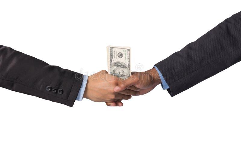 Passi la scossa fra un uomo d'affari con i soldi del dollaro sulla parte posteriore di bianco immagini stock