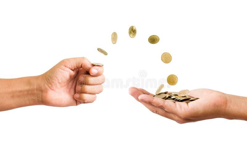 Passi a vibrazione le monete alla palma delle mani fotografia stock