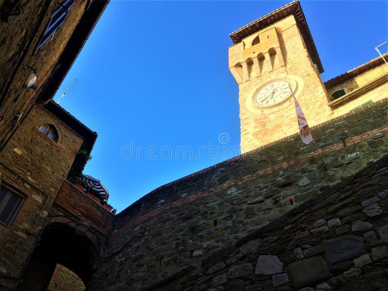 Passignano sul Trasimeno ancient town, Umbria region, Italy. Tower, clock, wall and history. Passignano sul Trasimeno ancient town, Umbria region, Italy. History royalty free stock photo