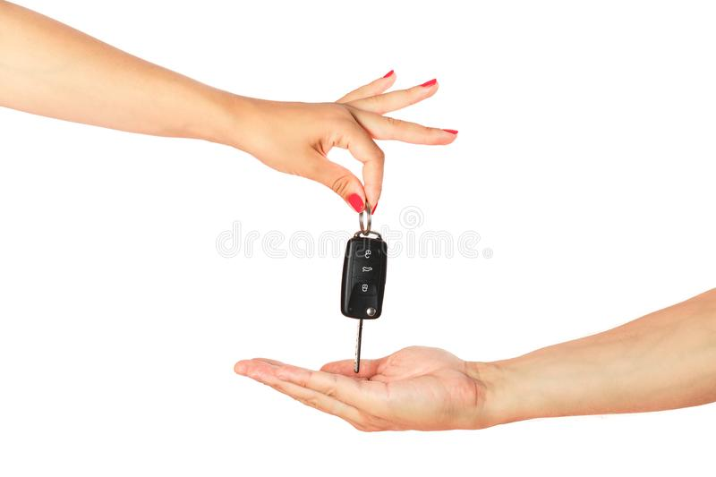 Passing car key isolated. Woman hand passing to man hand car key isolated on white background stock image