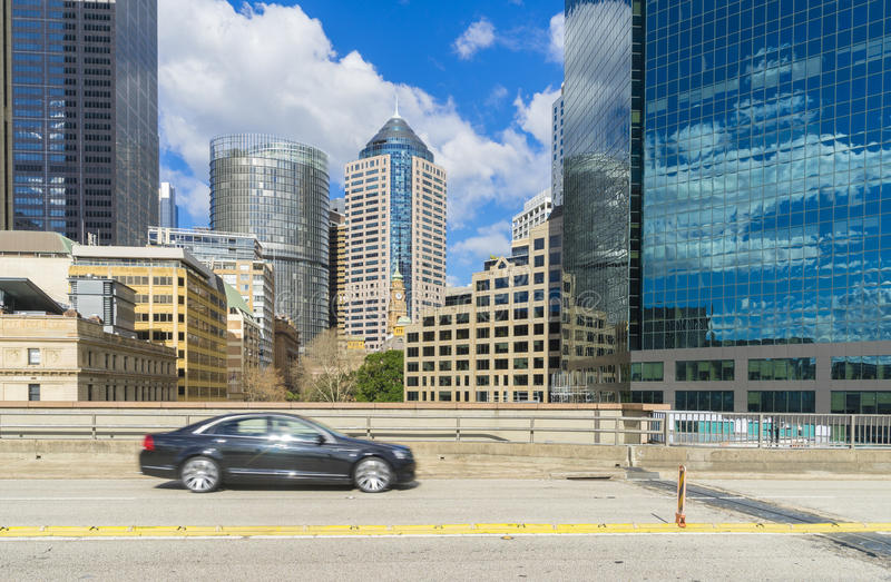 Passing car on motorway with skyscrapers of Sydney, Australia. During daytime stock images