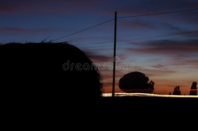 Passing cars in country road at dusk. 
