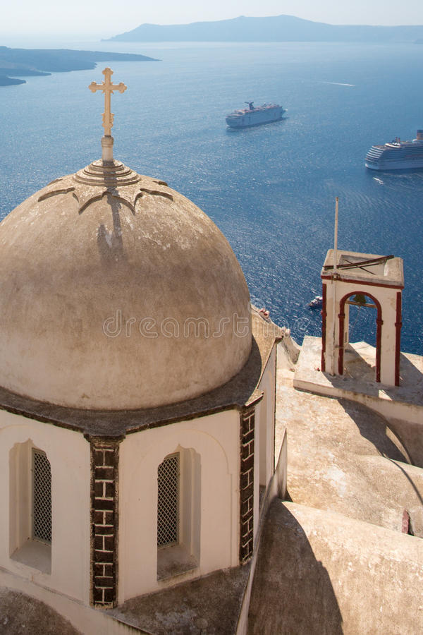 Passing cruise-boats and ornamented orthodox cross royalty free stock photos