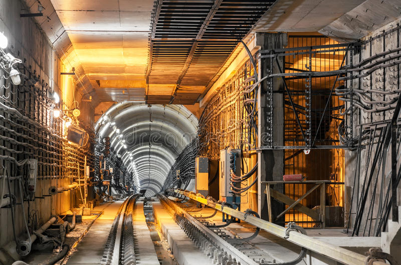 Passing down the underground subway tunnel stock photos