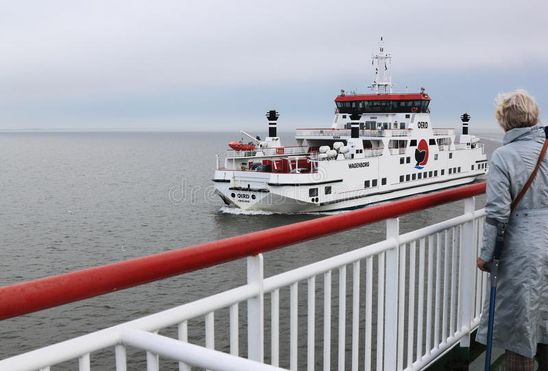 Passing ferries between Frysian Holwerd and Ameland stock photo