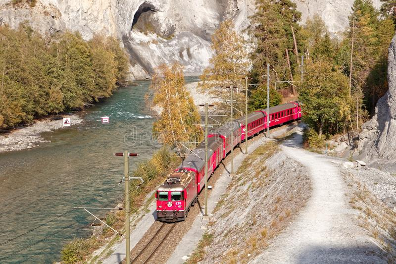 Passing by Glacier Express train in sunny autumnal Ruinaulta royalty free stock photos