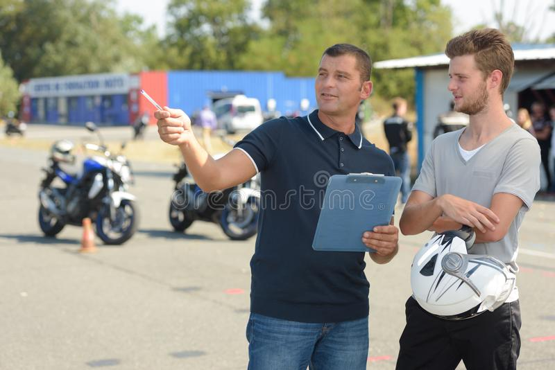 Passing motorbike drivers license. Passing a motorbike drivers license royalty free stock photo