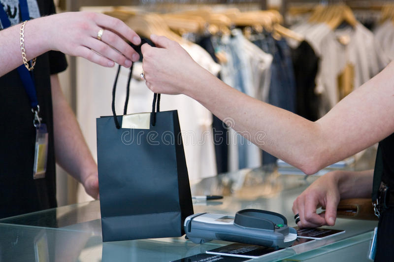 Passing the shopping bag royalty free stock images