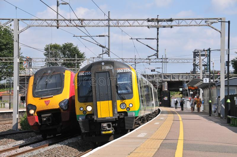 Passing trains at Lichfield Trent Valley. West Midlands Trains Siemens Desiro Electric Multiple Unit 350255 departs Lichfield Trent Valley with a London Euston royalty free stock image