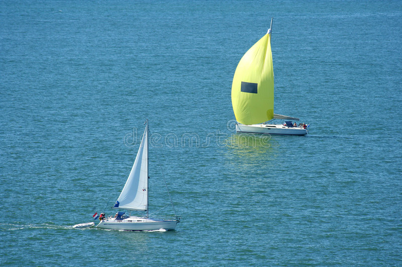 Passing yachts stock photos
