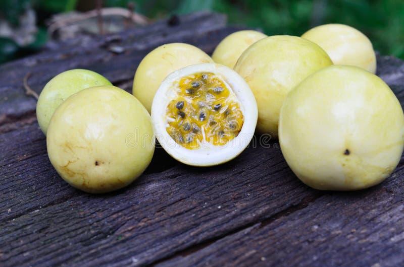 Passion fruit. Slice and fruit of Passion fruit on wood background royalty free stock image
