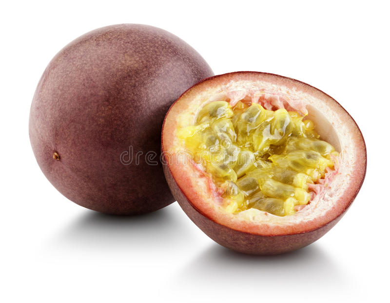 Passion fruit with cut half isolated on white. With clipping path stock image