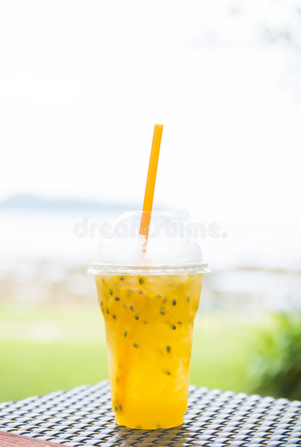 Passion fruit juice in plastic cups royalty free stock image