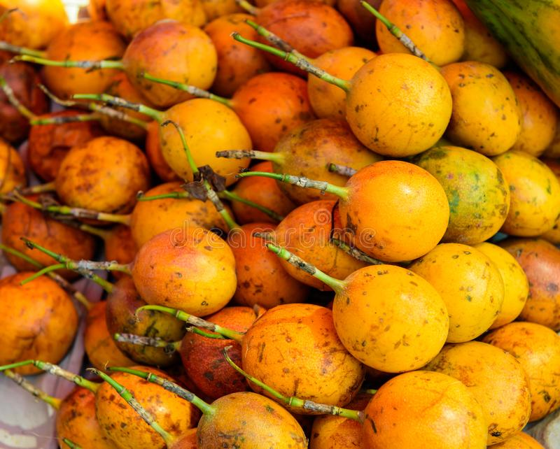 Many of passion fruit on market place. Close up. Background and texture royalty free stock photography