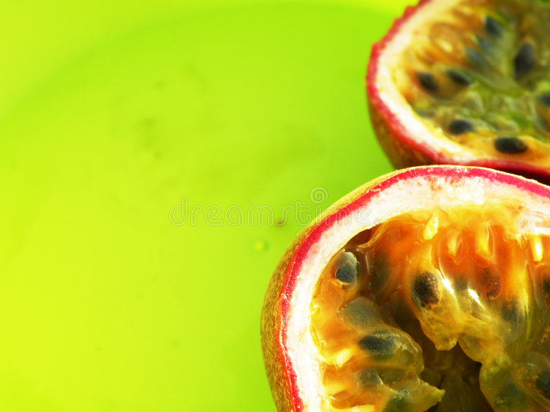 Passion fruit - Passiflora - Maracuja. Passion fruit (also know as Passiflora or Maracuja) on bright green background royalty free stock image