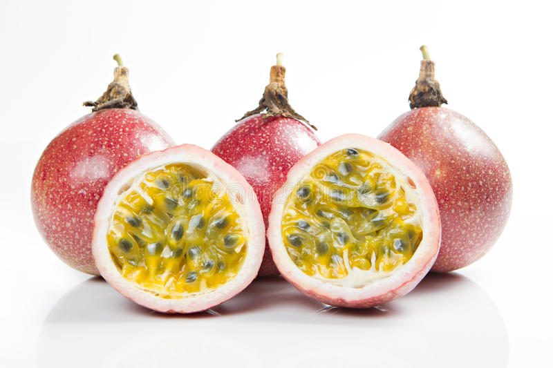 Passion fruits and slice isolated on white. stock images