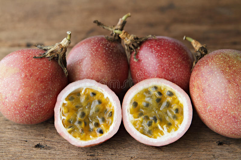 Passion fruits and slice on wooden. royalty free stock photos