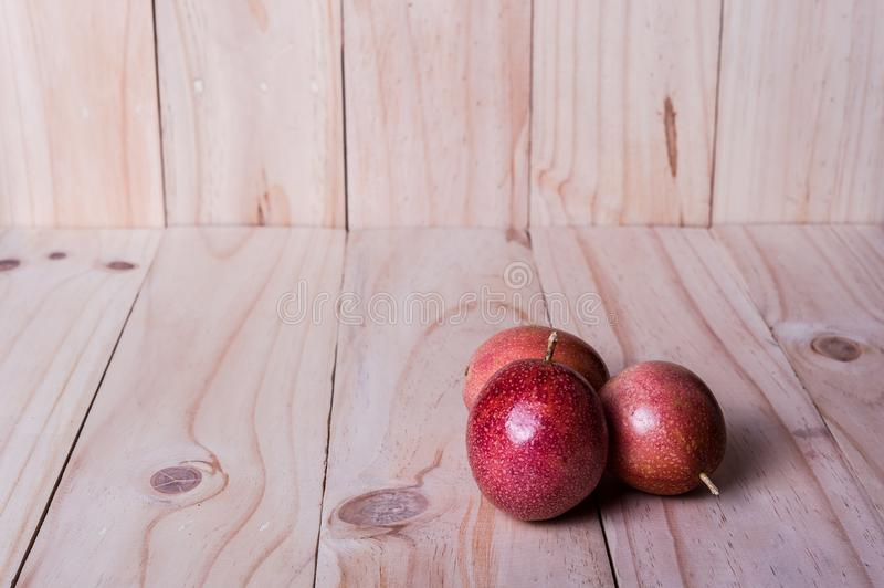 Passion fruits on wooden background. as package design element royalty free stock photos