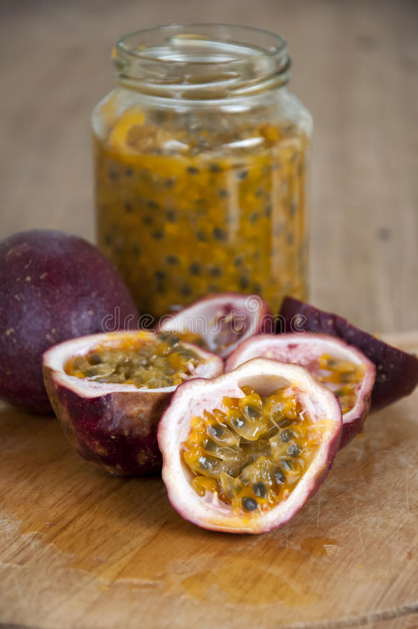 Passion fruits on wooden background stock image