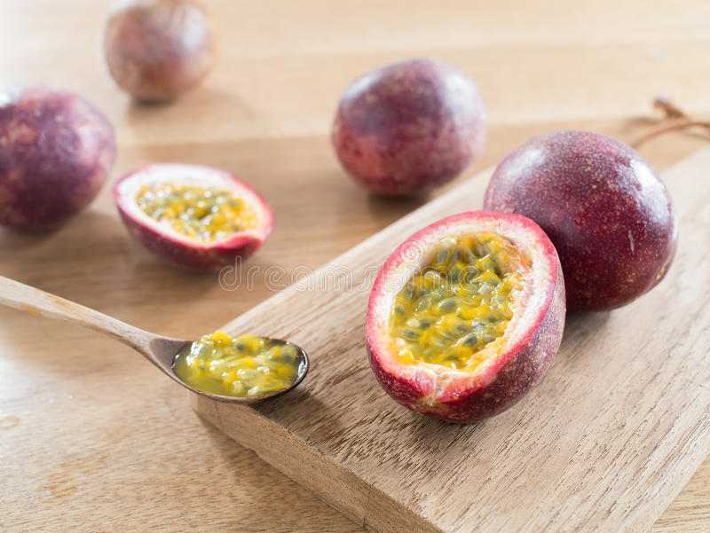 Passion fruits on wooden cutting board royalty free stock photos