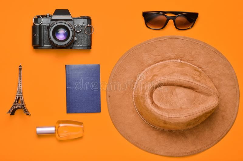 Passion for travel, wanderlust concept. Trip to France, Paris. Felt hat, film camera, sunglasses, passport, perfume bottle, souven. Ir statuette of the Eiffel stock photography