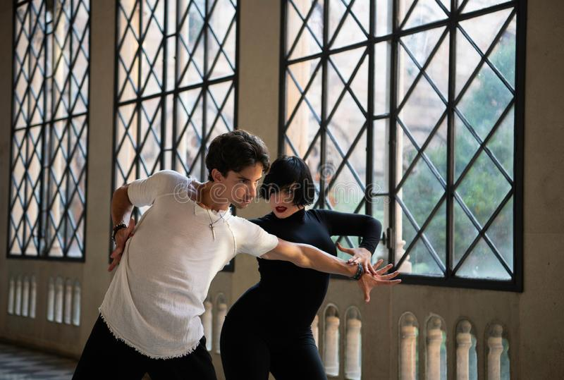 Passionate Dancers In Motion Of Performance.Dancing couple royalty free stock photography