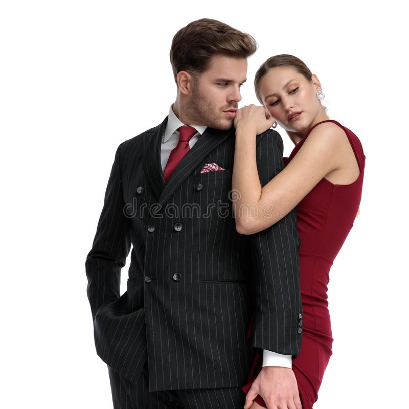 Passionate couple being dressed elegant stock photo