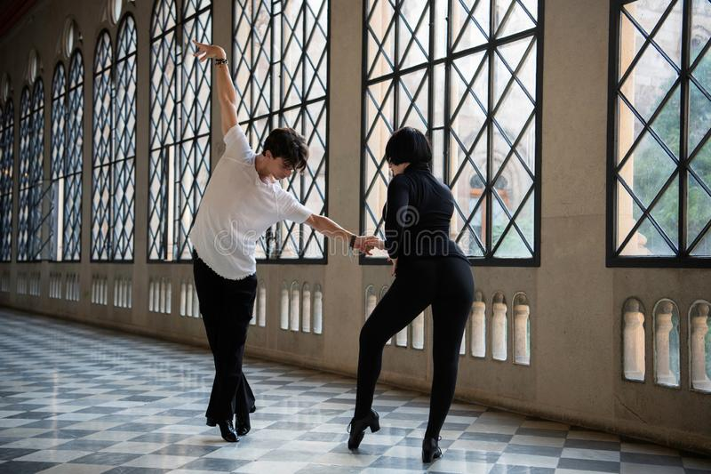 Passionate couple of   Dancers In Motion Of Performance. Passionate couple of  Ballroom Dancers In Motion Of Performance.Couple dancing in the hall stock photography