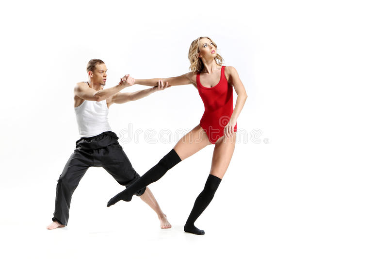Passionate dance of two people. Couple in a pose of modern dance women wearing a outfit stock images