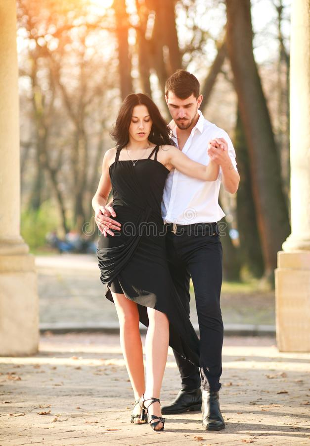 Passionate elegant young couple latino dancers in tango in the park. Romantic and sporty lifestyle royalty free stock photo