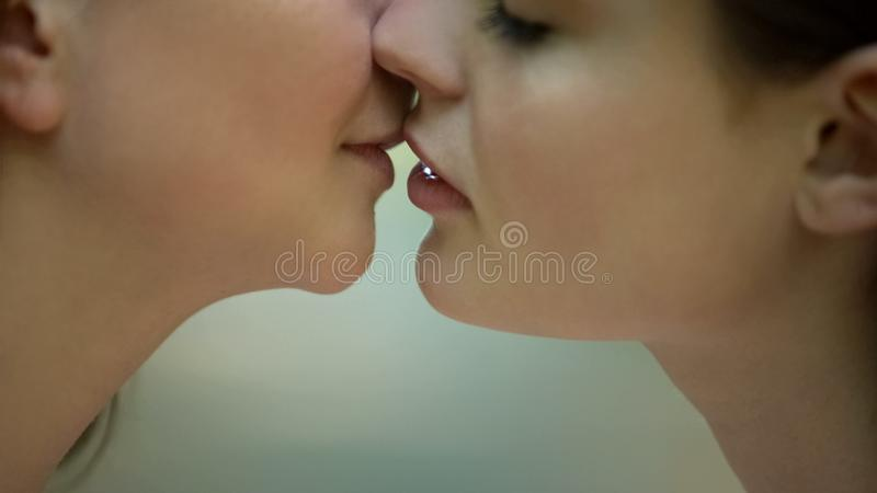 Passionate lesbian kiss, intimate meeting, right to same-sex relationships stock images