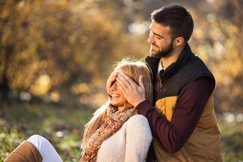 Passionate love in the autumn park. A young couple stock photo
