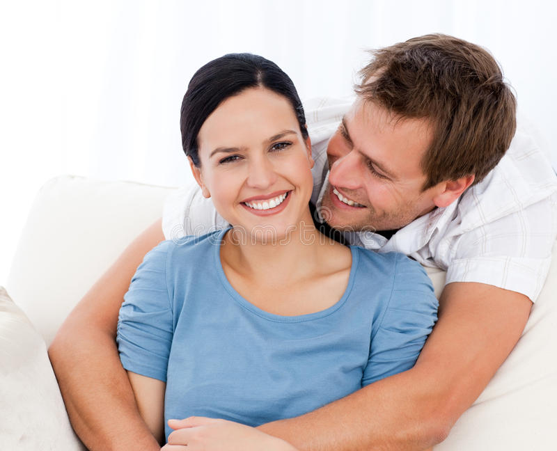 Passionate man hugging his girlfriend royalty free stock images
