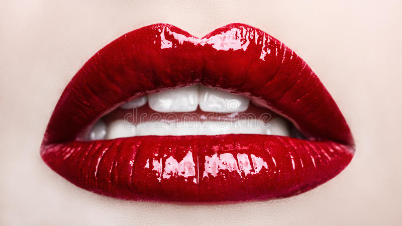 Passionate red lips. Opened mouth. Beautiful makeup close up. royalty free stock photos