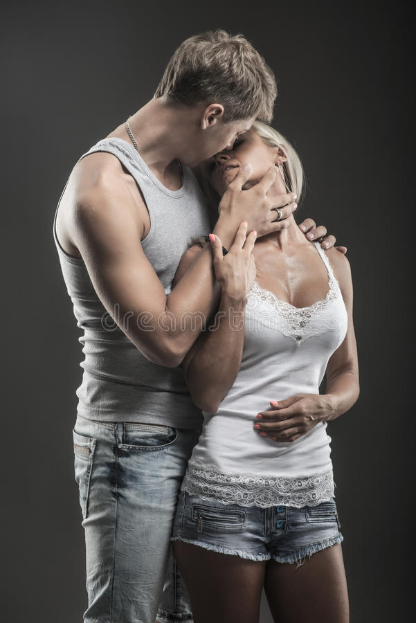 Passionate young couple in love on dark royalty free stock images