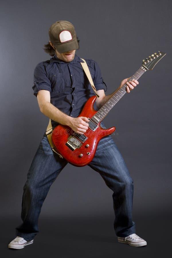 passionerad gitarristhatt arkivfoton