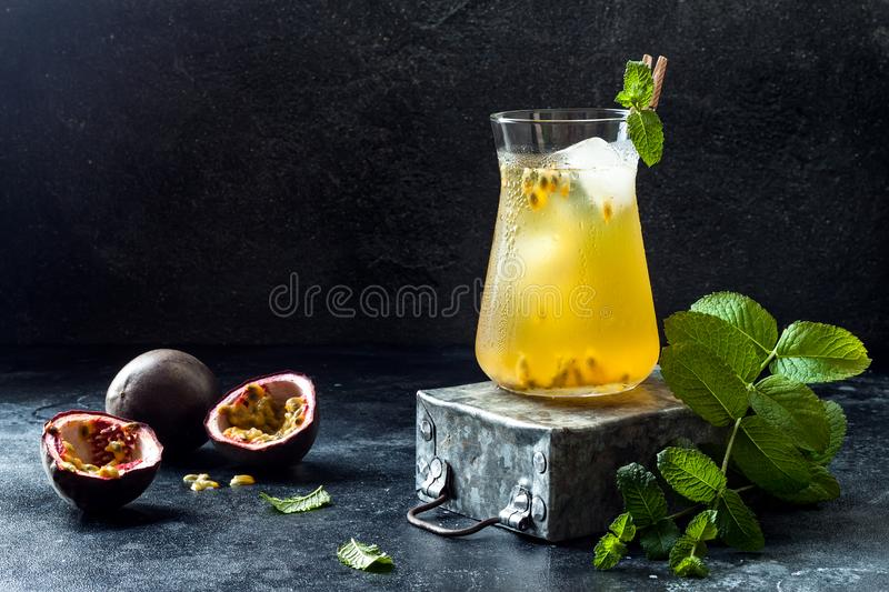 Passionfruit iced green tea or lemonade with lime and mint. Tropical refreshing cold drink. For summer stock images
